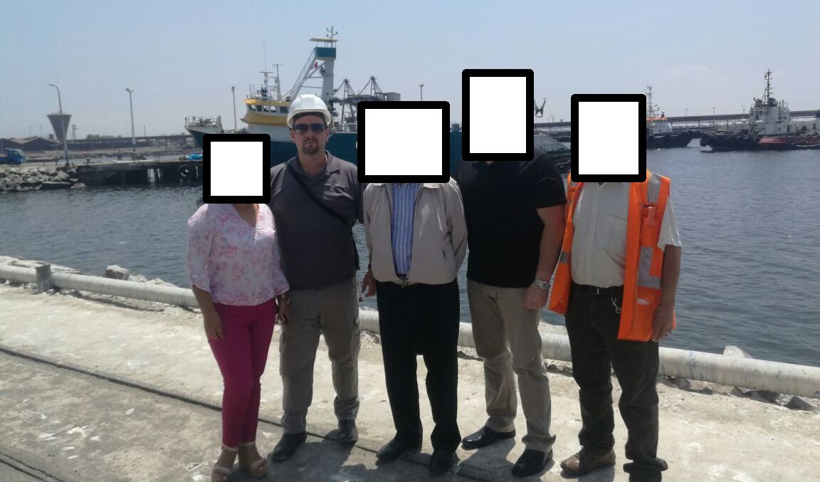 Nathan Hall at the Chimbote Port With Local Port Officials